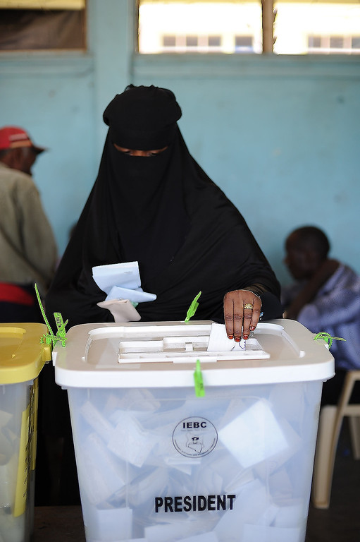 Description of . A Somali-Kenyan woman in the Eastleigh neighborhood of Nairobi votes at Eastleigh High School during the elections on March 4, 2013. Long lines of Kenyans queued from far before dawn to vote Monday in the first election since the violence-racked polls five years ago, with a deadly police ambush hours before polling started marring the key ballot. The tense elections are seen as a crucial test for Kenya, with leaders vowing to avoid a repeat of the bloody 2007-8 post-poll violence in which over 1,100 people were killed, with observers repeatedly warning of the risk of renewed conflict.    Jennifer Huxta/AFP/Getty Images