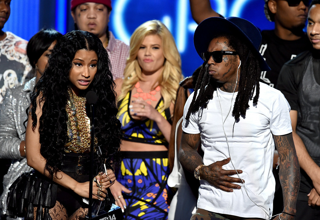 Description of . Singer Nicki Minaj (L) and rapper Lil Wayne of Young Money accept Best Group onstage during the BET AWARDS '14 at Nokia Theatre L.A. LIVE on June 29, 2014 in Los Angeles, California.  (Photo by Kevin Winter/Getty Images for BET)