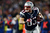 Wes Welker #83 of the New England Patriots runs with the ball against the Houston Texans during the 2013 AFC Divisional Playoffs game at Gillette Stadium on January 13, 2013 in Foxboro, Massachusetts.  (Photo by Elsa/Getty Images)