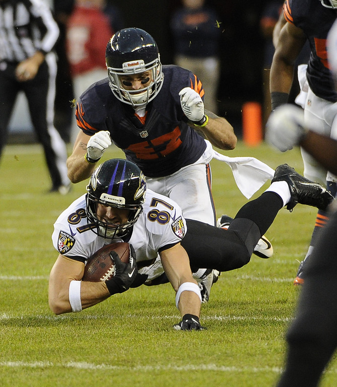 Description of . Dallas Clark #87 of the Baltimore Ravens makes a catch and is tackled by Chris Conte #47 of the Chicago Bears during the first quarter on November 17, 2013 at Soldier Field in Chicago, Illinois. (Photo by David Banks/Getty Images)
