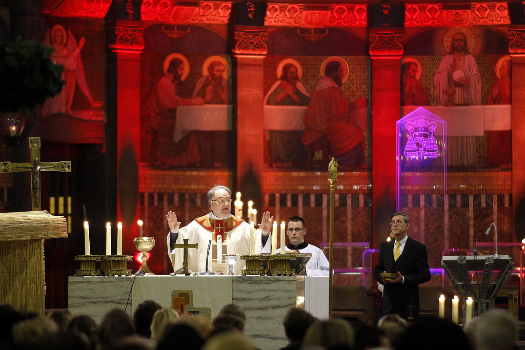 Description of . A priest celebrates a mass in the Cathedral of Rotterdam on Christmas Eve, on December 24, 2013.    BAS CZERWINSKI/AFP/Getty Images
