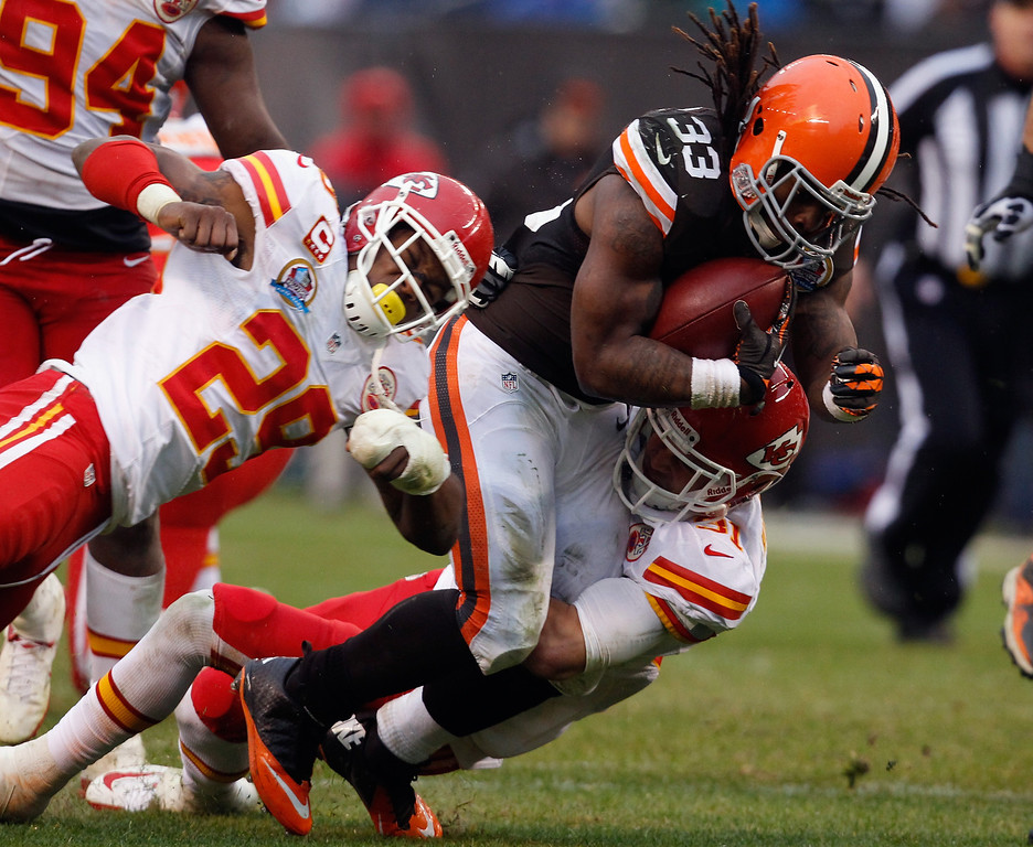 Description of . CLEVELAND, OH - DECEMBER 09:  Running back Trent Richardson #33 of the Cleveland Browns runs the ball as he is hit by safety Eric Berry #29 and defensive back Tysyn Hartman #31 of the Kansas City Chiefs at Cleveland Browns Stadium on December 9, 2012 in Cleveland, Ohio.  (Photo by Matt Sullivan/Getty Images)