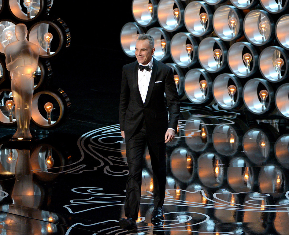 Description of . Presenter Daniel Day-Lewis walks on stage during the Oscars at the Dolby Theatre on Sunday, March 2, 2014, in Los Angeles.  (Photo by John Shearer/Invision/AP)