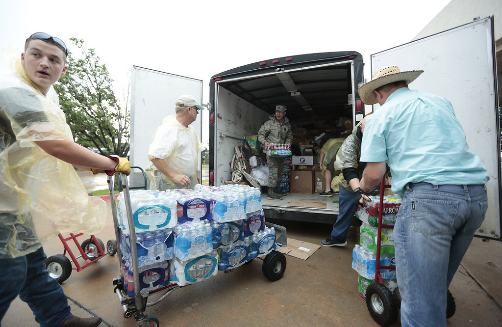 Description of . MOORE, OK -  MAY 23:   Volunteers unload donations for tornado victims at the First Baptist Church May 23, 2013  in Moore, Oklahoma. The tornado of at least EF4 strength and up to two miles wide touched down May 20 killing at least 24 people and leaving behind extensive damage to homes and businesses. U.S. President Barack Obama promised federal aid to supplement state and local recovery efforts.    (Photo by Brett Deering/Getty Images)