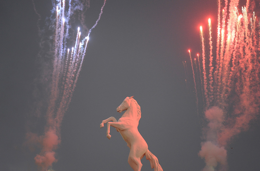 Description of . Fireworks light up the Bronco statue during the National Anthem before the game between the Broncos and the Ravens. (Photo by John Leyba/The Denver Post)