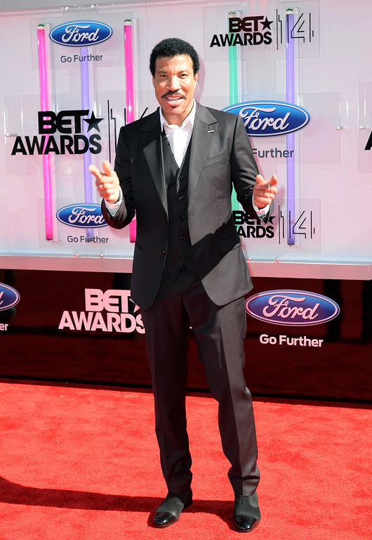 Description of . Singer/songwriter and Lifetime Achievement Honoree Lionel Richie attends the BET AWARDS '14 at Nokia Theatre L.A. LIVE on June 29, 2014 in Los Angeles, California.  (Photo by Earl Gibson III/Getty Images for BET)