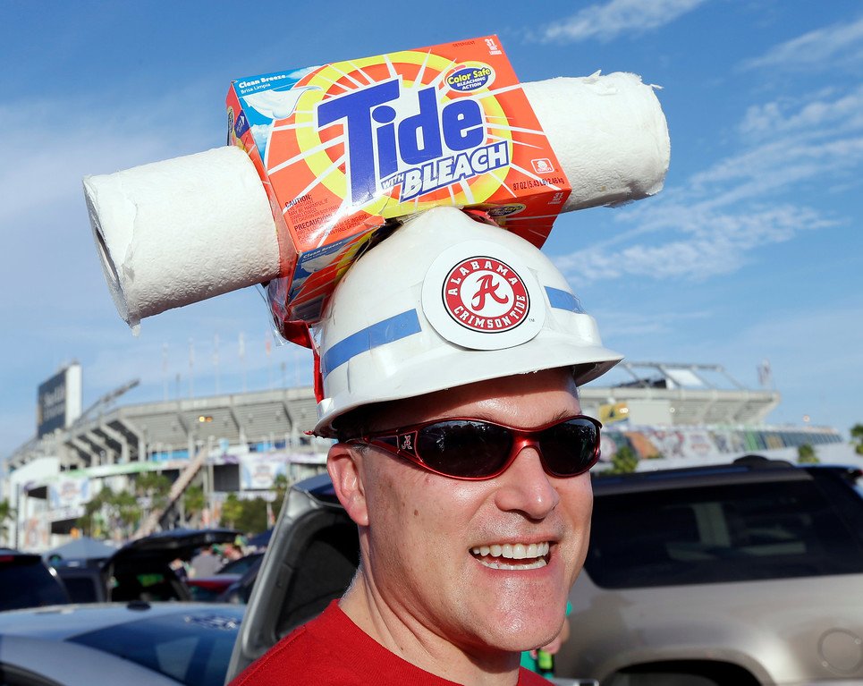 Description of . Brian Dawes of Decatur, Ala., makes his way to Sun Life Stadium before the BCS National Championship college football game between the Alabama and the Notre Dame Monday, Jan. 7, 2013, in Miami. (AP Photo/Chris O'Meara)