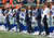 Dallas Cowboys players hang their heads during a moment of silence honoring teammate Jerry Brown who was killed in an automobile accident, prior to an NFL football game against the Cincinnati Bengals at Paul Brown Stadium in Cincinnati, Ohio, December 9, 2012.       REUTERS/John Sommers II