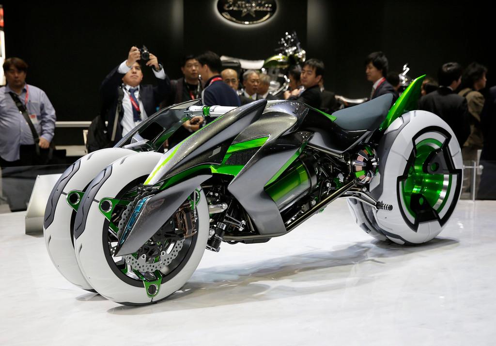 Description of . Kawasaki Motors introduces the electric tricycle J at the 43rd Tokyo Motor Show 2013 in Tokyo, Japan, 20 November 2013.   EPA/KIMIMASA MAYAMA