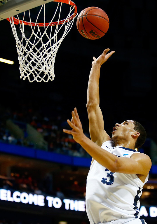 Description of . BUFFALO, NY - MARCH 20: Josh Hart #3 of the Villanova Wildcats goes up for a layup against the Milwaukee Panthers during the second round of the 2014 NCAA Men's Basketball Tournament at the First Niagara Center on March 20, 2014 in Buffalo, New York.  (Photo by Jared Wickerham/Getty Images)
