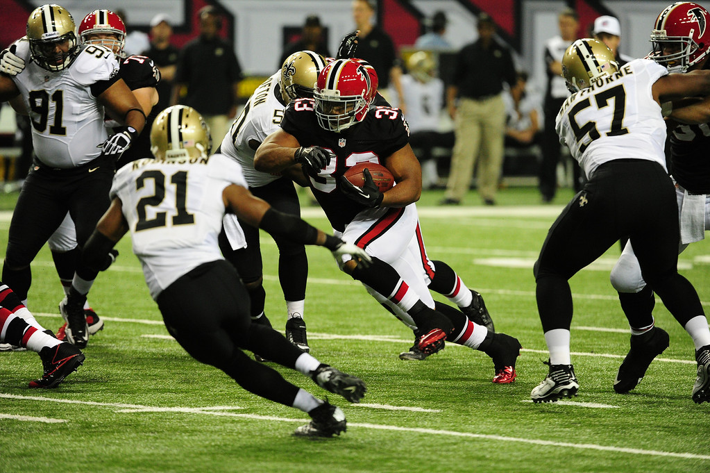 Description of . ATLANTA, GA - NOVEMBER 18:  Michael Turner #33 of the Atlanta Falcons carries the ball against the New Orleans Saints at the Georgia Dome on November 29, 2012 in Atlanta, Georgia  (Photo by Scott Cunningham/Getty Images)