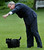 President Bush points in the direction his dog, Barney, should go following his arrival on Marine One helicopter on the South Lawn of the White House Monday, May 5, 2003 in Washington. The president earlier visited Arkansas on his way back to Washington following a weekend at his Texas ranch. (AP Photo/Pablo Martinez Monsivais)