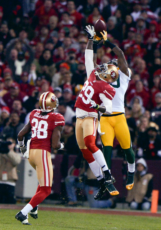 Description of . San Francisco 49ers cornerback Chris Culliver (29) tries to break up a 44-yard pass to Green Bay Packers' James Jones during the first quarter in the NFC Divisional Playoff on Saturday, January 12, 2013, at Candlestick Park in San Francisco, California. (Jose Carlos Fajardo/San Jose Mercury News)