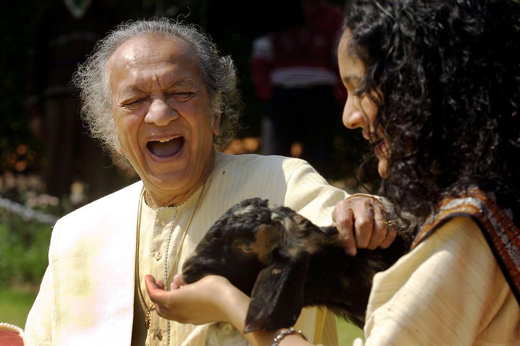 . FILE - In this Feb. 25, 2002 file photo, Sitar maestro Pandit Ravi Shankar, left, and his daughter Anoushka Shankar laugh during the shooting of a film endorsing the strengthening of Indian laws against animal cruelty in New Delhi. Shankar, the sitar virtuoso who became a hippie musical icon of the 1960s after hobnobbing with the Beatles and who introduced traditional Indian ragas to Western audiences over an eight-decade career, died Tuesday, Dec. 11, 2012. He was 92. (AP photo/Gurinder Osan, File)