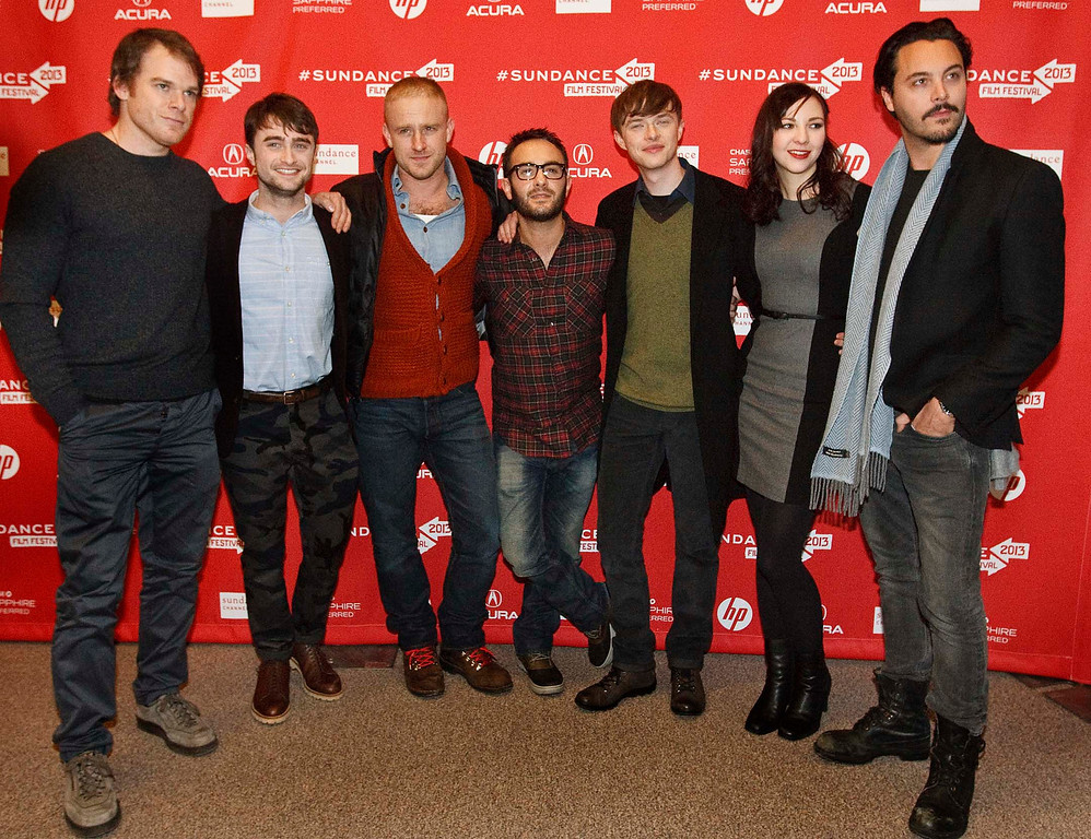 Description of . l-r Michael C. Hall, Daniel Radcliffe, Ben Foster, director John Krokidas, Dane DeHaan, Erin Darke and Jack Huston pose for pictures before the premiere of