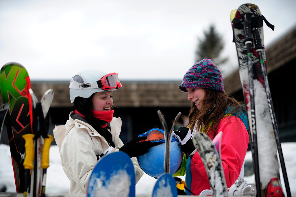 Description of . ASPEN, CO. - JANUARY 24:   Kendall Tomkins, 18,  left, and Jordan Lally, 15, of Virginia Beach, Virginia, joke about their goggles after skiing on Buttermilk Mountain at the 2013 Aspen X Games. They come to the area to ski and see the X Games every year.  (Photo By Mahala Gaylord / The Denver Post)