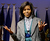 This March 3, 2009 file photo shows first lady Michelle Obama reacts as Retired Gen. Wilma L. Vaught, not shown, speaks at Arlington National Cemetery's Women in Military Service for America Memorial Center in Arlington, Va..(AP Photo/Alex Brandon,File)