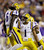LSU safety Craig Loston (6) celebrates his fumble recovery with safety Eric Reid (1) during the first half of the Chick-fil-A Bowl NCAA college football game against Clemson, Monday, Dec. 31, 2012, in Atlanta. (AP Photo/David Goldman)