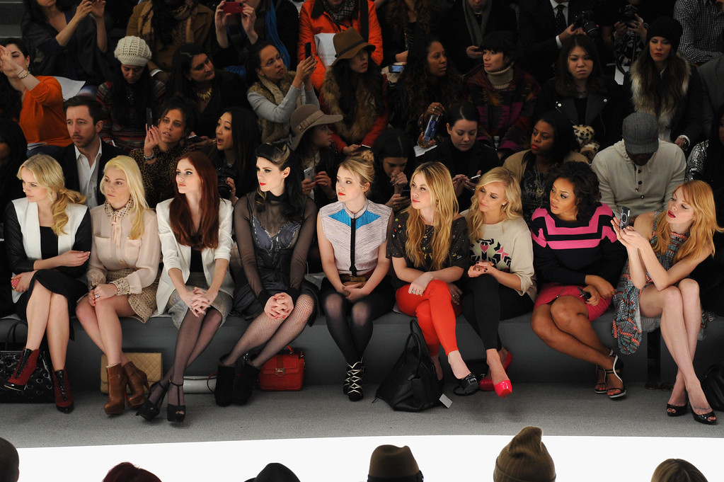 . NEW YORK, NY - FEBRUARY 09:  (L-R) Actress Helena Mattsson, guest, Alyssa Campanella, singer Kate Nash, actress Taylor Spreitler, Olympian Tara Lipinski, Olympian Nastia Liukin, Angela Simmons, and actress Nicole LaLiberte attend the Mara Hoffman Fall 2013 fashion show during Mercedes-Benz Fashion Week at The Stage at Lincoln Center on February 9, 2013 in New York City.  (Photo by Mike Coppola/Getty Images for Mercedes-Benz Fashion Week)