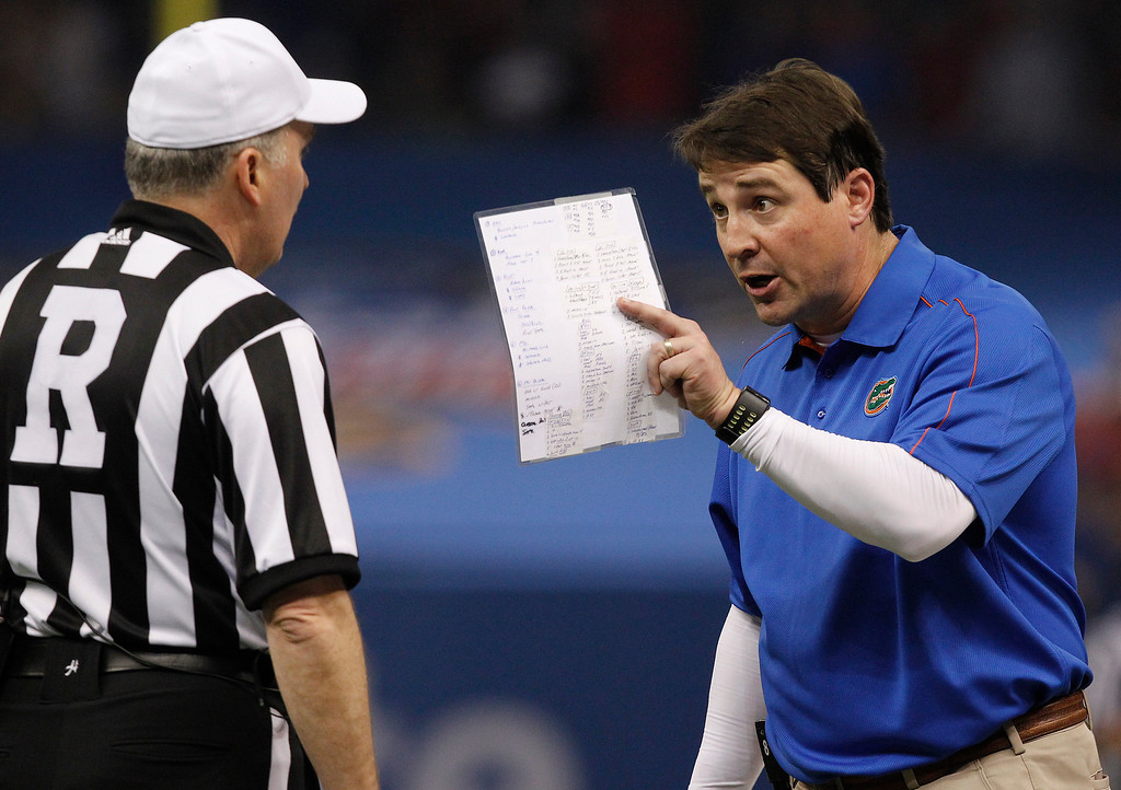 Description of . Florida head coach Will Muschamp argues with an official in the first half of the Sugar Bowl NCAA college football game against Louisville Wednesday, Jan. 2, 2013, in New Orleans. (AP Photo/Butch Dill)