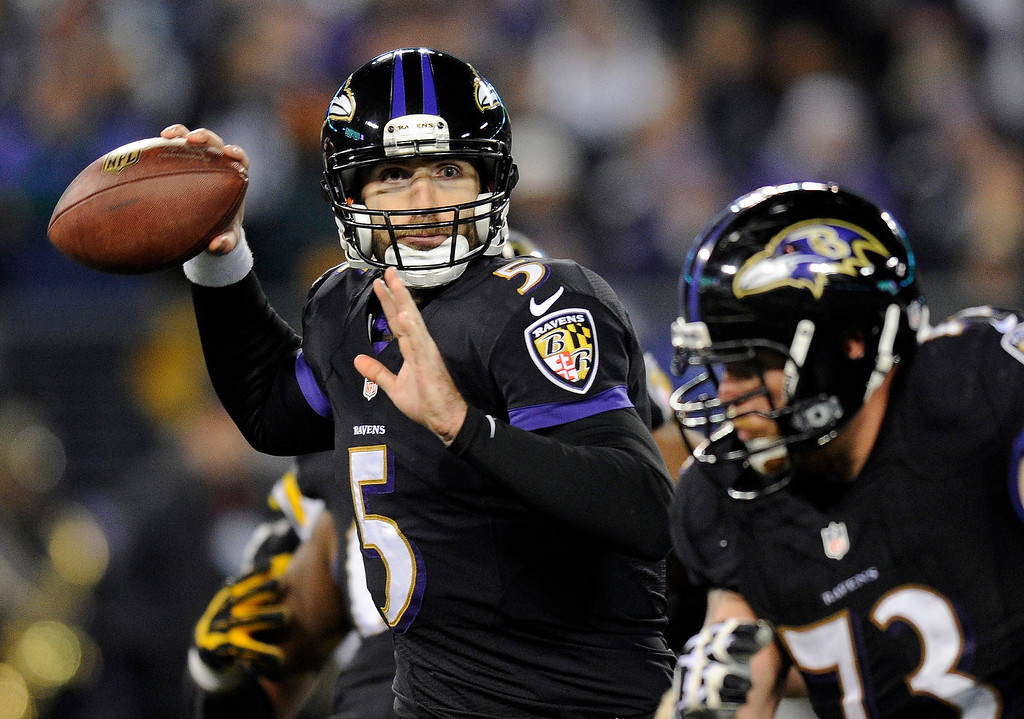 Description of . Baltimore Ravens quarterback Joe Flacco (5) throws to a receiver in the first half of an NFL football game against the Pittsburgh Steelers, Thursday, Nov. 28, 2013, in Baltimore. (AP Photo/Nick Wass)