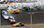 Carl Edwards (99) and Trevor Bayne (21) go sideways during a multi-car crash including David Gilliland (38), Terry Labonte (32), David Ragan (34) and Ricky Stenhouse Jr., (17) during the NASCAR Daytona 500 Sprint Cup Series auto race at Daytona International Speedway, Sunday, Feb. 24, 2013, in Daytona Beach, Fla. Marcos Ambrose (9) goes low to avoid the crash. (AP Photo/Jim Topper)