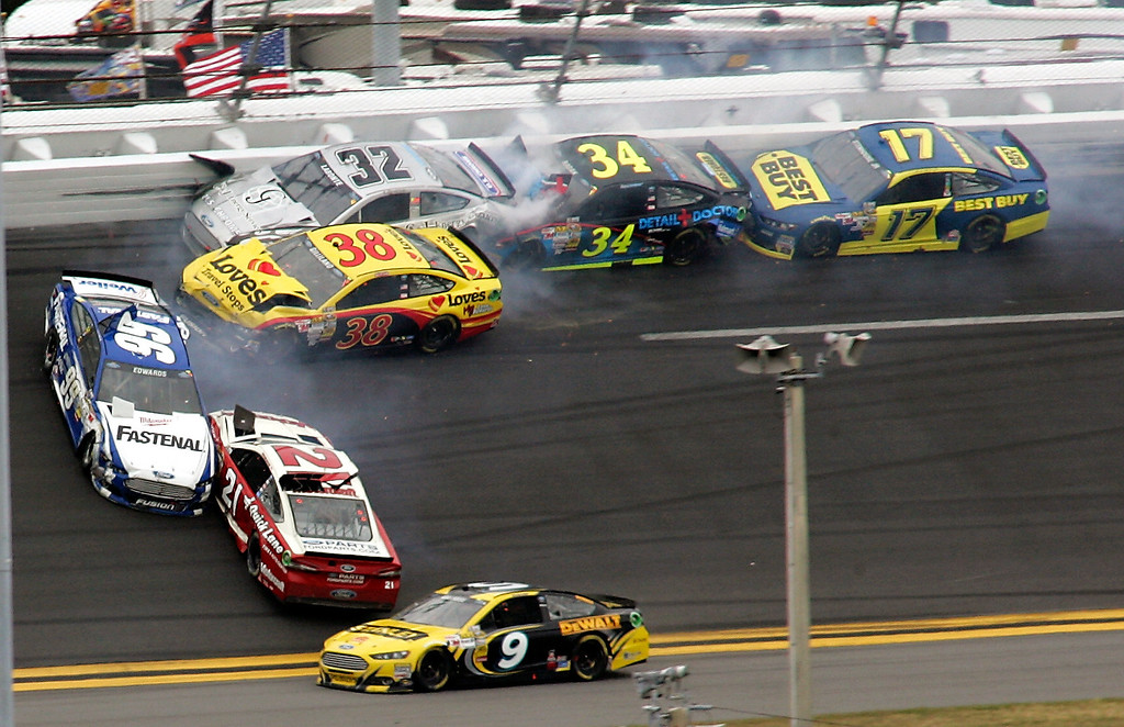Description of . Carl Edwards (99) and Trevor Bayne (21) go sideways during a multi-car crash including David Gilliland (38), Terry Labonte (32), David Ragan (34) and Ricky Stenhouse Jr., (17) during the NASCAR Daytona 500 Sprint Cup Series auto race at Daytona International Speedway, Sunday, Feb. 24, 2013, in Daytona Beach, Fla. Marcos Ambrose (9) goes low to avoid the crash. (AP Photo/Jim Topper)