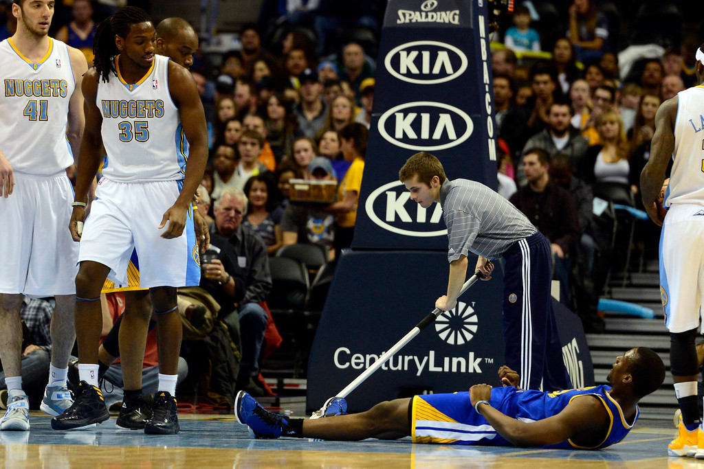 Description of . Denver Nuggets small forward Kenneth Faried (35) looks down after being fouled by Golden State Warriors small forward Harrison Barnes (40) during the first half at the Pepsi Center on Sunday, January 13, 2013. AAron Ontiveroz, The Denver Post