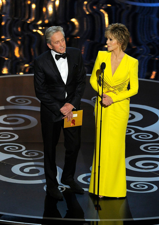 Description of . Actors Jane Fonda, right, and Michael Douglas present an award during the Oscars at the Dolby Theatre on Sunday, Feb. 24, 2013, in Los Angeles. (Photo by Chris Pizzello/Invision/AP)