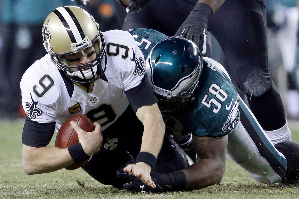Description of . Philadelphia Eagles' Trent Cole (58) tackles New Orleans Saints' Drew Brees (9) during the first half of an NFL wild-card playoff football game, Saturday, Jan. 4, 2014, in Philadelphia. (AP Photo/Matt Rourke)