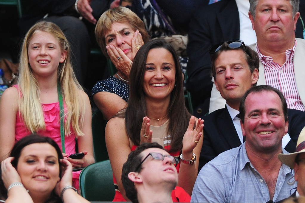 Description of . LONDON, ENGLAND - JULY 05:  Pippa Middleton applauds as she watches the Gentlemen\'s Singles semi-final match between Andy Murray of Great Britain and Jerzy Janowicz of Poland on day eleven of the Wimbledon Lawn Tennis Championships at the All England Lawn Tennis and Croquet Club on July 5, 2013 in London, England.  (Photo by Mike Hewitt/Getty Images)