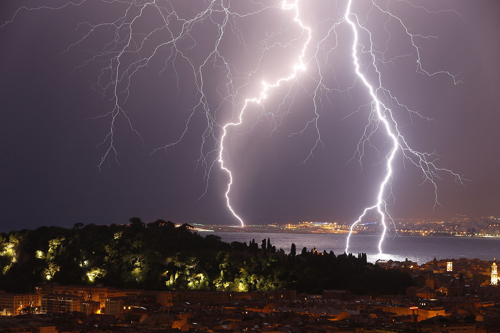 Description of . Flashes of lightning strike above the
