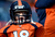 Broncos fan Charlie Lewis, age 6, from Cheyenne, WY watches the players warm up.  The Denver Broncos vs The Tampa Bay Buccaneers at Sports Authority Field Sunday December 2, 2012. John Leyba, The Denver Post