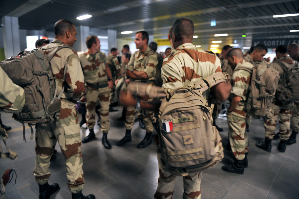 Description of . Soldiers of the first Parachute Chasseur Regiment (RCP) of Pamiers and of the 35th Parachute Artillery Regiment (RAP) of Tarbes wait for their luggage as they come back from the Serval military operation in Mali, at the Toulouse-Blagnac airport, southwestern France, on April 11, 2013. The first French soldiers came back from Mali on April 11, marking the gradual withdrawal of the French troops, three months after the beginning of the Serval operation in the African country.  ERIC CABANIS/AFP/Getty Images