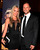Oscar Pistorius (R) and his girlfriend Reeva Steenkamp pose for a picture in Johannesburg in this February 7, 2013 file photograph. The airing of a Caribbean reality TV show featuring the girlfriend of Paralympic star Oscar Pistorius two days after she was shot dead has upset some South Africans. REUTERS/Thembani Makhubele/Files