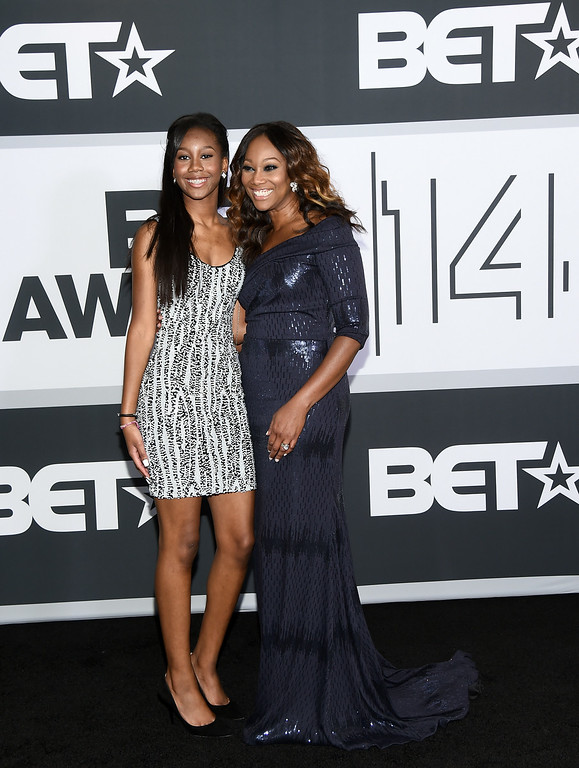 Description of . Taylor Ayanna Crawford (L) and singer Yolanda Adams pose in the press room during the BET AWARDS '14 at Nokia Theatre L.A. LIVE on June 29, 2014 in Los Angeles, California.  (Photo by Michael Buckner/Getty Images for BET)