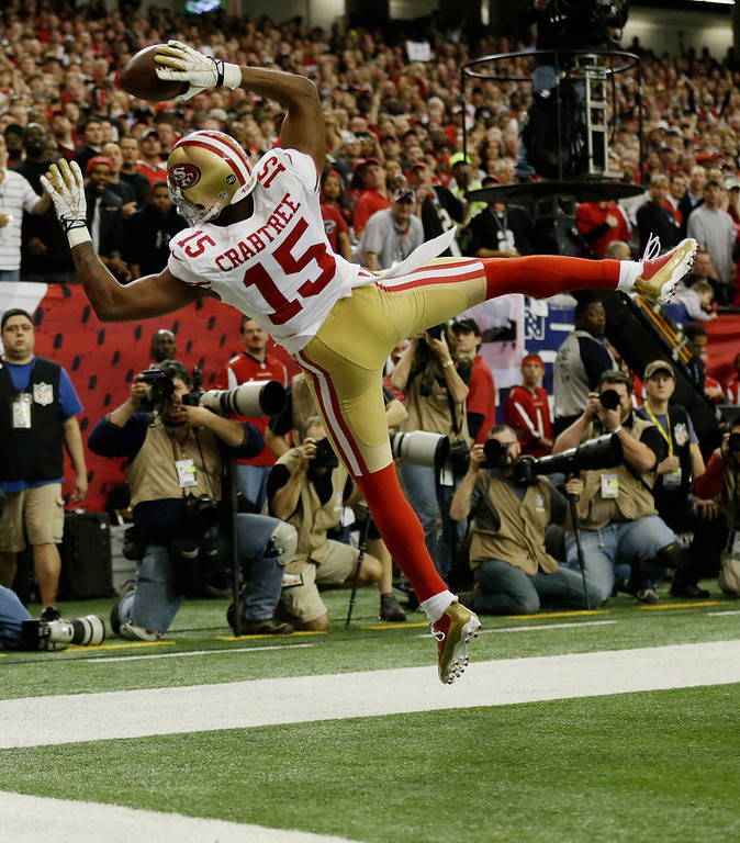 Description of . San Francisco 49ers\' Michael Crabtree can\'t keep his feet in bounds as he catches a ball during the first half of the NFL football NFC Championship game against the Atlanta Falcons Sunday, Jan. 20, 2013, in Atlanta. (AP Photo/David Goldman)