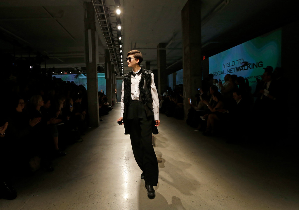 Description of . Models walk the runway at the conclusion of the presentation of the Kenneth Cole Fall 2013 fashion collection during Fashion Week in New York, Thursday, Feb. 7, 2013.  (AP Photo/Kathy Willens)
