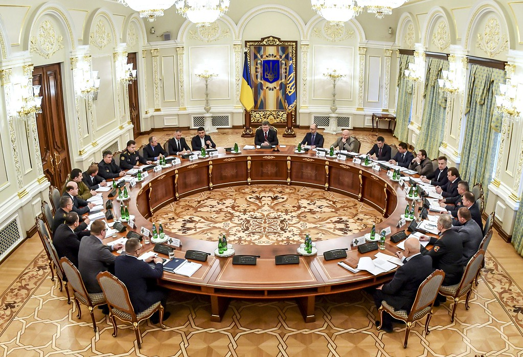 Description of . This handout picture taken and released by the Ukrainian presidential press-service on January 25, 2015 shows Ukrainian President Petro Poroshenko (C) heading an emergency meeting of the National Security and Defence Council in Kiev. Ukraine's President Petro Poroshenko was chairing an emergency security meeting to forge a response to a new offensive by pro-Russian rebels after rocket strikes on a vital government-held port killed 30 people. MYKOLA LAZARENKO/AFP/Getty Images