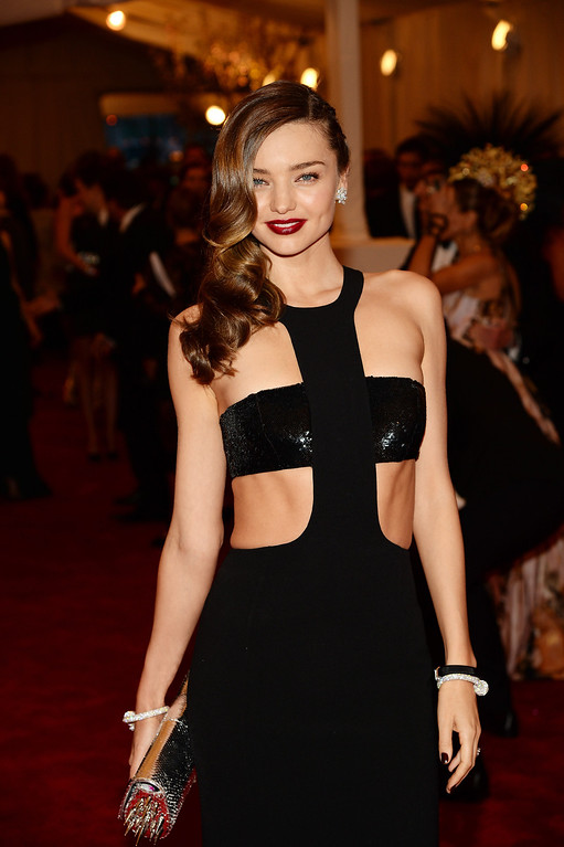 Description of . NEW YORK, NY - MAY 06:  Model Miranda Kerr attends the Costume Institute Gala for the
