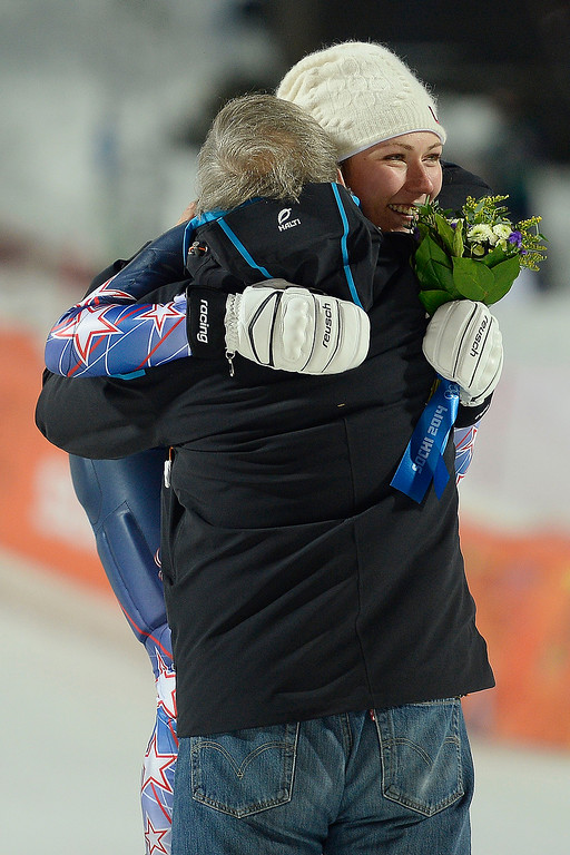 Description of . Gold medalist Mikaela Shiffrin hugs U.S. Ski President Bill Marolt after ladies' slalom run 2. Sochi 2014 Winter Olympics on Friday, February 21, 2014 at Rosa Khutor Alpine Center. (Photo by AAron Ontiveroz/ The Denver Post)