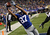 Domenik Hixon #87 of the New York Giants pulls in a pass for a touchdown in front of Jabari Greer #33 of the New Orleans Saints during their game at MetLife Stadium on December 9, 2012 in East Rutherford, New Jersey.  (Photo by Jeff Zelevansky/Getty Images)