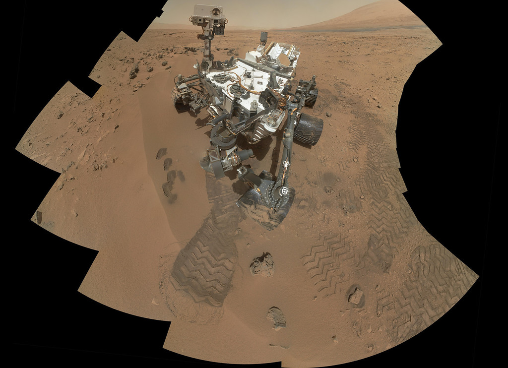 Description of . This image released by NASA shows the work site of the NASAís rover Curiosity on Mars. Results are in from the first test of Martian soil by the rover Curiosity: So far, there is no definitive evidence that the red planet has the chemical ingredients to support life.Scientists said Monday, Dec. 3, 2012 that a scoop of sandy soil analyzed by the rover\'s chemistry lab contained water and a mix of chemicals, but not the complex carbon-based compounds considered necessary for microbial life. (AP Photo/NASA)