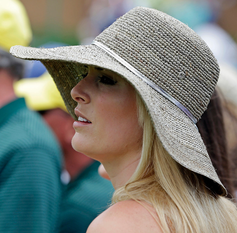 Description of . Skier Lindsey Vonn watches Tiger Woods on the ninth hole during the first round of the Masters golf tournament Thursday, April 11, 2013, in Augusta, Ga. (AP Photo/Darron Cummings)