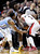 Portland Trail Blazers guard Wesley Matthews (2) is double-teamed by Denver Nuggets' Andre Iguodala, left, and Kenneth Faried during the first quarter of an NBA basketball game in Portland, Ore., Wednesday, Feb. 27, 2013. (AP Photo/Don Ryan)
