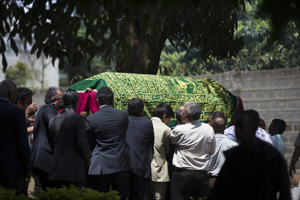 Description of . Relatives and friends carry the coffin of a victim of the at the Westgate Mall attack, during her funeral ceremony on September 26, 2013 in Nairobi, Kenya.   (Photo by Uriel Sinai/Getty Images)