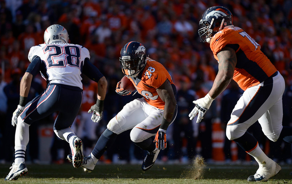 Description of . Denver Broncos running back Montee Ball (28) makes an 8-yard run to and the third quarter. The Denver Broncos take on the New England Patriots in the AFC Championship game at Sports Authority Field at Mile High in Denver on January 19, 2014. (Photo by AAron Ontiveroz/The Denver Post)