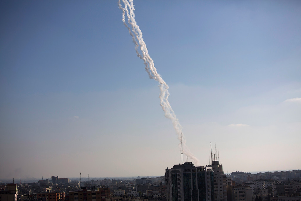 Description of . Rockets are fired from Gaza Strip towards Israel, Thursday, July 31, 2014, as international efforts to end the 23-day-old conflict seemed to sputter despite concern over the mounting death toll. (AP Photo/Dusan Vranic)