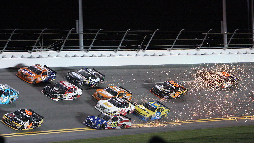 Description of . Travis Pastrana (60) gets loose in turn 4 causing a multi car crash in the NASCAR Nationwide auto race at Daytona International Speedway, Friday, July 5, 2013, in Daytona Beach, Fla. (AP Photo/Darryl Graham)