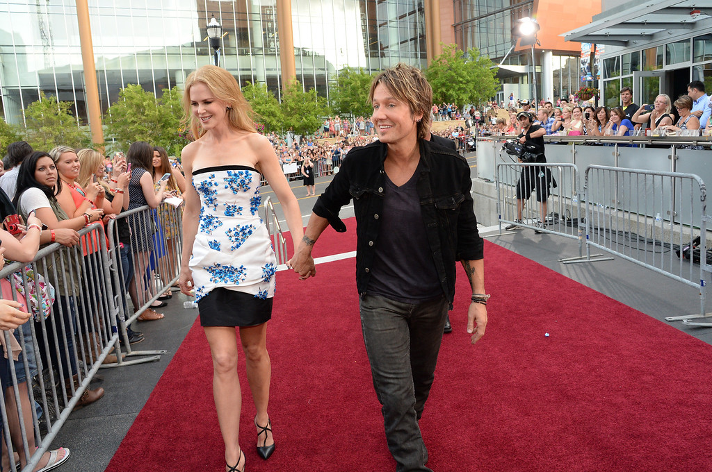 Description of . Nicole Kidman and Keith Urban attend the 2014 CMT Music Awards at Bridgestone Arena on June 4, 2014 in Nashville, Tennessee.  (Photo by Rick Diamond/Getty Images for CMT)